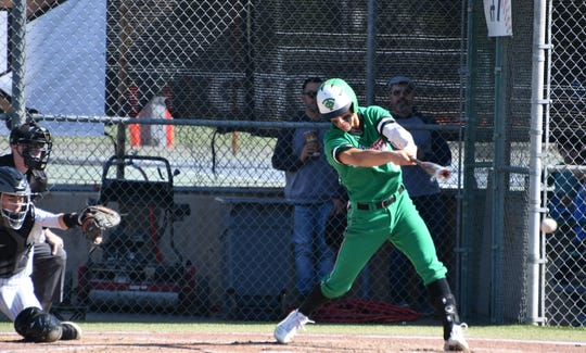 Max Muncy puts the bat on the ball during a game against Granada Hills Charter on Feb. 15. The Thousand Oaks standout hopes to break a few program hitting records held by his head coach — former major league star Jack Wilson.