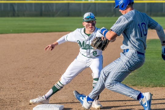 El Diamante's Joey Fonseca outs Clovis' Noah Beal at third in a non-league high school baseball game on Thursday, February 20, 2020.