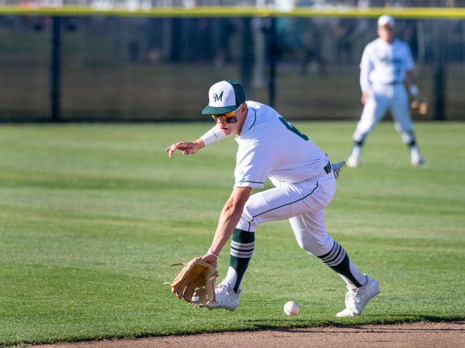 El Diamante's Cole Yoshida fields a hit ball against Clovis in a non-league high school baseball game on Thursday, February 20, 2020.