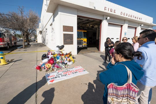 Passersby leave flowers and notes on Thursday, February 20, 2020 in memory of the two firefighters lost in Tuesday's fire at the Porterville library.