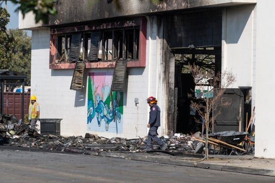 Fire crews from Visalia, Tulare and other agencies remove debris from the Porterville library on Thursday, February 20, 2020. Two firefighters were killed when the building went up in flames on Tuesday.