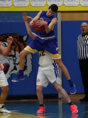 Ardsley's Miles Cooperman (14) pulls down a rebound in front of North Salem's Steven Herlihy (32) during Section 1 Class B boys basketball playoff action at North Salem High School School  Feb. 20, 2020. North Salem won the game 53-33.