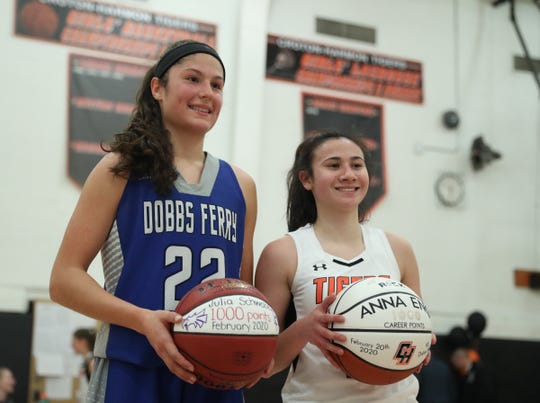 Dobbs Ferry's Julia Schwabe (22) , left, and Croton's Anna Eng (2) both hit the milestone of 1,000-points during the opening round of girls Class B playoffs at Croton-Harmon High School in Croton-on-Hudson on Thursday, February 20, 2020.