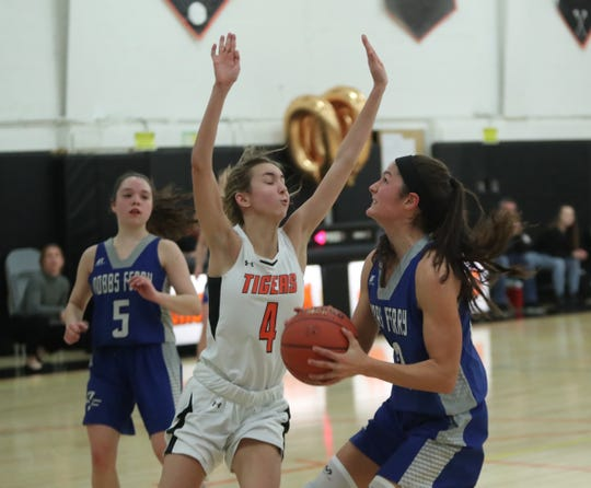 Dobbs Ferry's Julia Schwabe (22) looks to take a shot over Croton's Sophia Tuman (4) during their 60-43 win over Croton-Harmon in the opening round of girls Class B playoffs at Croton-Harmon High School in Croton-on-Hudson on Thursday, February 20, 2020.