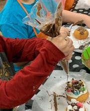 """Kids can have fun at a birthday party hosted by Chocolatier Matisse in Orangeburg. At this gourmet candy shop, """"every party ends with a chocolate experience,"""" says owner Danielle Hudak."""