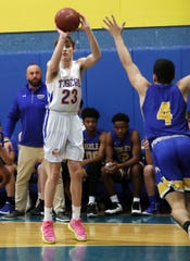 North Salem's Roger Squire (23) puts up a shot against Ardsley during the Section 1 Class B boys basketball playoff at North Salem High School School  Feb. 20, 2020. North Salem won the game 53-33.
