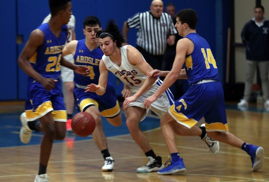 North Salem's Kevin Ryan (15) tries to get around Ardsley's Miles Cooperman (14) and Luke Martini (4) during Section 1 Class B boys basketball playoff action at North Salem High School School  Feb. 20, 2020. North Salem won the game 53-33.