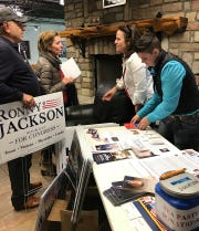Campaign literature and signs were available Thursday at the Wichita Falls Tea Party forum for 13th Congressional District Republican candidates.