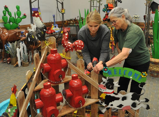 Posada Pots' Susan Cummings and Patti decorate for the annual Arts Alive Home and Garden Festival held each year at the Wichita Falls MPEC.