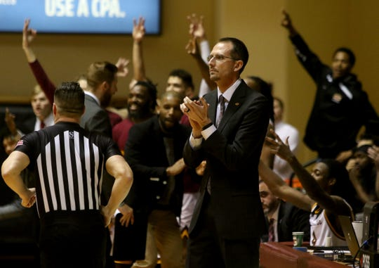 Midwestern State head basketball coach Justin Leslie claps for his team in the game against Arkansas-Fort Smith Thursday, Feb. 20, 2020, at D.L. Ligon Coliseum.