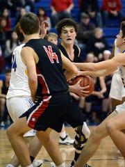Crooksville's Caden Miller grabs the ball in traffic against West Muskingum.