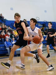 West Muskingum's Kyle Reilly drives into the lane against Crooksville's Blake White on Thursday night at Gary Ankrum Gymnasium. Reilly scored 23 of his 25 points in the second half in the Tornadoes' 78-71 loss.