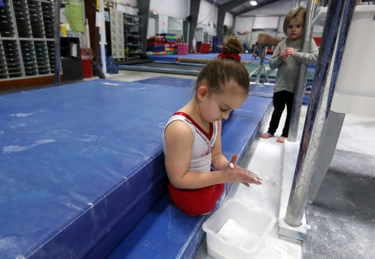 Paige Calendine gets ready to practice her bars routine at Zanesville Gymnastics on Thursday.
