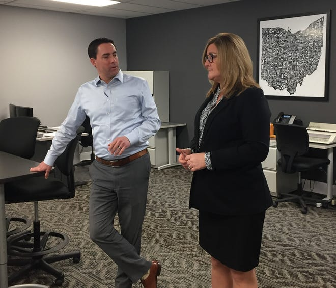 Secretary of State Frank LaRose and Marlee Gibson, deputy director at Muskingum County Board of Elections discuss voting security and transparency at the elections office.