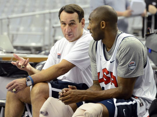 Mike Krzyzewski talks with Kobe Bryant during practice in preparation for the 2012 London Olympic Games.
