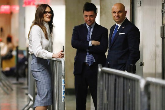 Defense attorneys Donna Rotunno, Damon Cheronis and Arthur Aidala confer in the hallway during jury deliberations in the Harvey Weinstein sex-crimes trial in New York, Feb. 21, 2020.