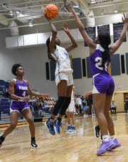 D.W. Daniel junior Sincere Hicks(10) shoots near Ridge View forward Laila Acox during the first quarter of Class AAAA Region III playoffs at D.W. Daniel High School in Central Friday.