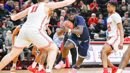 Monmouth's Ray Salnave (0) scored a team-high 13 points, including three free throws late in regulation to send the game to overtime, in a 65-61 victory over Marist on Friday night.