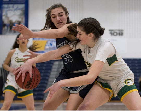 Shore Conference Tournament girls basketball quarterfinal game featuring Manasquan vs Red Bank Catholic. Manasquan's Mary Donnelly (33) defends as RBC's Justine Pissott looks to pass. Toms River, NJSaturday, February 22, 2020