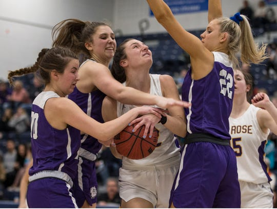 Shore Conference Tournament girls basketball quarterfinal game featuring St. Rose vs Rumson-Fair Haven. St. Rose's Brynn Farrell puts up a shot as Rumson's Lucy Adams defends.Toms River, NJSaturday, February 22, 2020