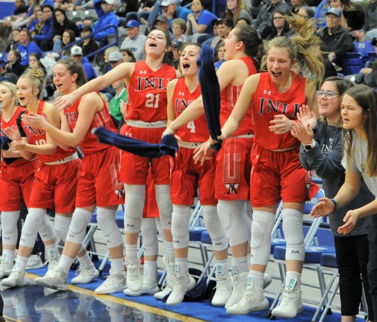 Members of the Jim Ned girls basketball team react after a play against Childress in a Region I-3A area playoff Friday, Feb. 21, 2020, at Stamford High School.