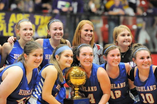 The Highland girls basketball team poses for a picture with its area-round trophy after beating Munday in a Region II-1A area playoff Friday, Feb. 21, 2020, at Anson High School.