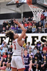 Cooper's Noah Garcia (3) floats a shot towards the basket during the District 4-5A seeding game against Wylie on Friday at Abilene High's Eagle Gym. The Cougars won 62-50 to claim the No. 3 seed.