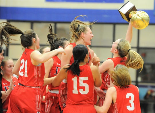The Jim Ned girls basketball team celebrates with its trophy after beating Childress in a Region I-3A area playoff Friday, Feb. 21, 2020, at Stamford High School