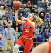 Jim Ned senior Brooke Galvin (33) goes for a shot against Childress in a Region I-3A area playoff Friday, Feb. 21, 2020, at Stamford High School.