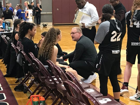 Elmira coach Jake Dailey talks to his team during a timeout in Friday's Southern Tier Athletic Conference title game against Oneonta at Johnson City. The Express won, 74-44.