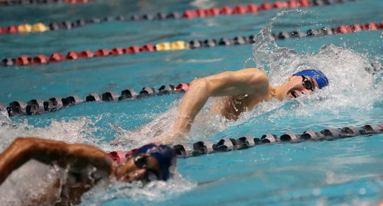 Olympic's Dietrich Meyer swims the 100 Yard Freestyle during the 2A State Swim Prelims at the King County Aquatic Center in Federal Way on Friday, Feb. 21, 2020.