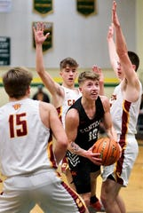 Central Kitsap's Colby White is surrounded by three Capital defenders during Friday's district playoff game.
