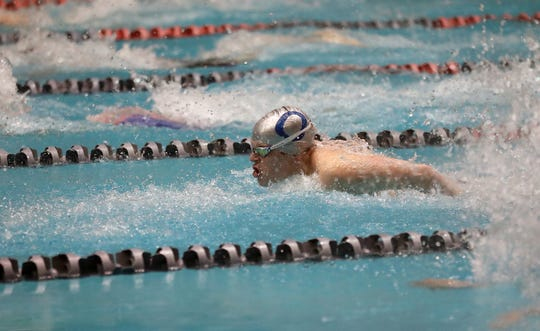 Olympic's Ryan Burchell swims the 100 Yard Butterfly during the 2A State Swim Prelims at the King County Aquatic Center in Federal Way on Friday, Feb. 21, 2020.