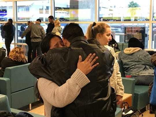 Vilma Diaz hugs her brother Jose Carlos Diaz before being deported to El Salvador on Feb. 22.