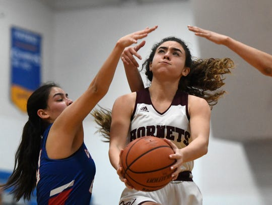 Flour Bluff's Bella Bertero prepares to shoot the ball against Mission Veterans Memorial, Friday, Feb. 21, 2020, in Kingsville. Flour Bluff won, 43-39.