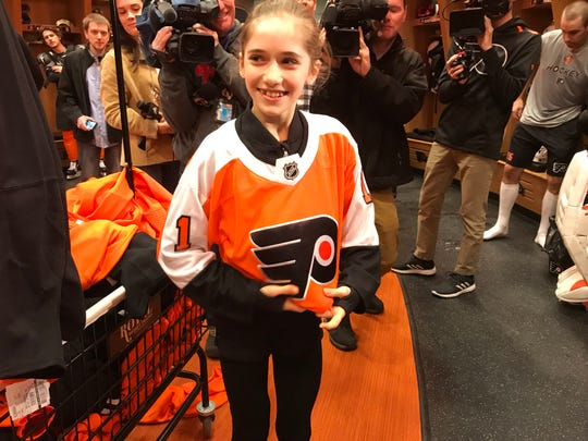 Isabeau Levito, 12, of Mount Laurel, performed well last month in the U.S. Figure Skating Championships. She has aspirations of skating in the 2026 Olympics. She met her favorite Flyer, Carter Hart, Friday afternoon.