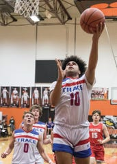 Zane Trace's Cam Evans goes up for a layup during a 56-50 win over Piketon in a D-III Sectional Final on Friday Feb. 21, 2020 in Waverly, Ohio.