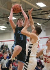Adena's Logan Bennett goes up for a shot during a 53-41 win over Alexander in a D-III Sectional Final on Friday Feb. 21, 2020 in Jackson, Ohio.
