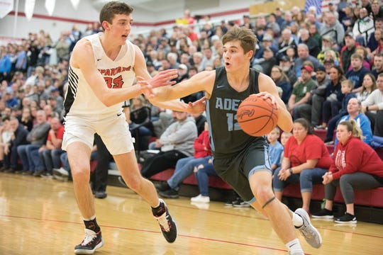 Adena's Preston Sykes dribbles near the baseline during a 53-41 win over Alexander in a D-III Sectional Final on Friday Feb. 21, 2020 in Jackson, Ohio.