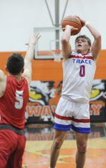 Zane Trace's Colby Swain goes up for a mid-range jump shot during a 56-50 win over Piketon in a D-III Sectional Final on Friday Feb. 21, 2020 in Waverly, Ohio.