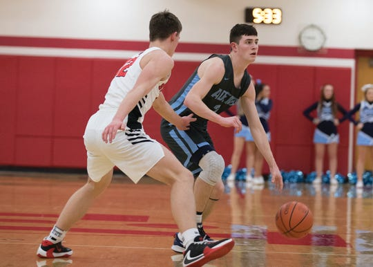 Adena's Nate Throckmorton dribbles outside of the perimeter during a 53-41 win over Alexander in a D-III Sectional Final on Friday Feb. 21, 2020 in Jackson, Ohio.