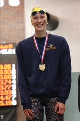Seven Hills' Ella Jo Piersma on the podium after winning the 200-yard freestyle at the OHSAA Swimming and Diving Championships in Canton, Ohio, Friday, Feb. 21, 2020.