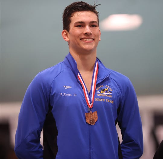 Seven Hills' Tim Kalin stands on the podium at the OHSAA Swimming and Diving Championships in Canton, Ohio, Friday, Feb. 21, 2020.
