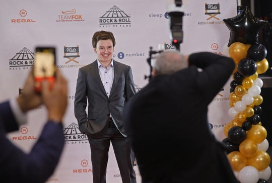 """Event organizer Ryan Levine poses for photos on the red carpet during the fourth annual """"Kids Film It Festival"""" at the Rock & Roll Hall of Fame and Museum on Friday, Feb. 21, 2020, in Cleveland, Ohio."""