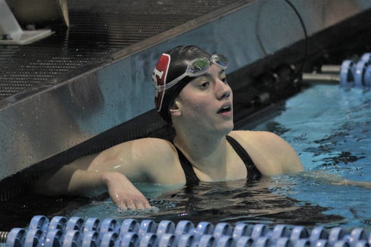Dixie Heights senior Selina Reil checks her time after finishing second in the 500 freestyle during the KHSAA state swimming and diving championships on Friday, Feb. 21, 2020, at the University of Kentucky in Lexington