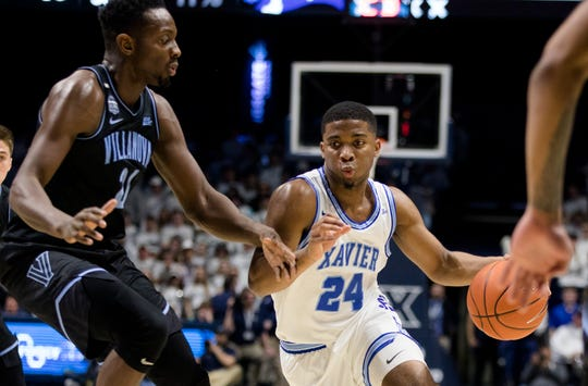 Xavier Musketeers guard KyKy Tandy (24) drives on Villanova Wildcats forward Dhamir Cosby-Roundtree (21) in the second half of the NCAA men's basketball game on Saturday, Feb. 22, 2020, in the Cintas Center at Xavier University.