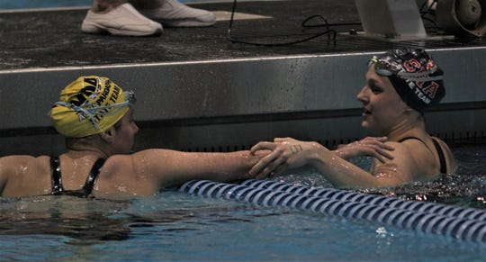 Notre Dame freshman Lainy Kruger greets Sacred Heart senior Claire Donan after the finals of the 200 individual medley during the KHSAA state swimming and diving championships on Friday, Feb. 21, 2020, at the University of Kentucky in Lexington.