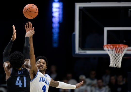 Villanova Wildcats forward Saddiq Bey (41) shoots over Xavier Musketeers forward Tyrique Jones (4) in the second half of the NCAA men's basketball game on Saturday, Feb. 22, 2020, in the Cintas Center at Xavier University.