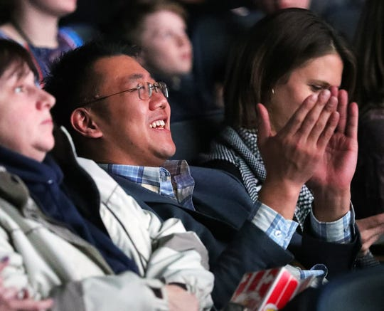 """A spectator applauds a young filmmaker's work during the fourth annual """"Kids Film It Festival"""" at the Rock & Roll Hall of Fame and Museum on Friday, Feb. 21, 2020, in Cleveland, Ohio."""