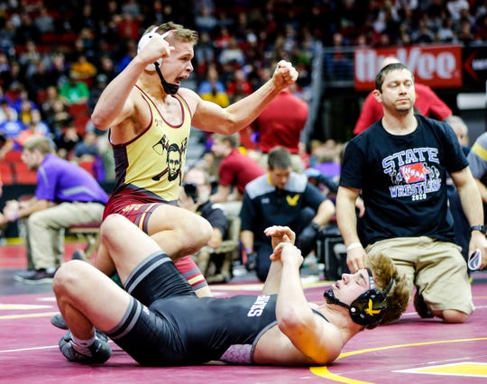 Mickey Griffith of Des Moines Lincoln defeated McCrae Hagarty of Waverly-Shell Rock during their 3a semifinal round match at Wells Fargo Arena Friday, Feb. 21, 2020.